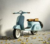 Vintage blue motorcycle vespa, by wall with fallen leaves  Pojazdy Obraz