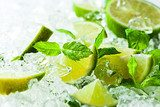 lime and leaves of mint with ice  Owoce Obraz