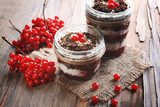 Delicious dessert in jars on table close-up  Owoce Obraz
