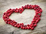 heart shape of fresh berries  Owoce Obraz