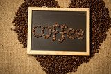 """coffee"" spelled by coffee beans on black chalkboard against lin  Obrazy do Jadalni Obraz"