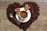 Cup of coffee with heart-shaped chocolate truffles.  Obrazy do Jadalni Obraz