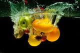 Fruit and vegetables splash into water  Obrazy do Jadalni Obraz