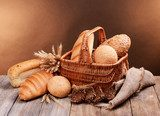 Different bread on table on brown background  Obrazy do Jadalni Obraz