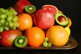 Assortment of fruits on table, close-up  Obrazy do Kuchni  Obraz