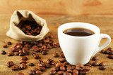 Cup of coffee with beans on rustic wooden background  Obrazy do Kuchni  Obraz
