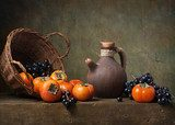 Still life with persimmons and grapes on the table  Owoce Obraz
