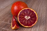 red blood sicilian orange whole, half and wedge  Owoce Obraz