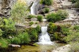 Nice waterfalls following each other over granite  Fototapety Wodospad Fototapeta