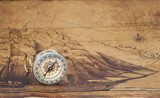 Vintage compass lies on an ancient map Styl Marynistyczny Fototapeta