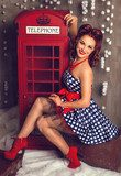 Red hair pin-up woman portrait near telephone booth Pin-up Obraz