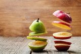 flying slices of fruit: apple, pear Owoce Obraz