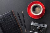 Desk with camera, supplies and coffee cup Biuro Plakat