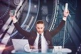 Composite image of businessman cheering holding calculator Plakaty do Biura Plakat