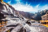 Beautiful bright landscape with waterfall and green trees Wodospad Fototapeta