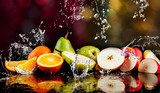 Pears, apples, orange  fruits and Splashing water Obrazy do Jadalni Obraz