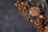 Black food background with cocoa, nuts and chocolate paste.  Obrazy do Jadalni Obraz