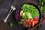 vegan lunch bowl. Avocado, red rice, tomato, cucumber, red cabbage, green peas vegetables salad Obrazy do Jadalni Obraz