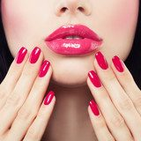 Makeup Lips with Pink Glossy Lipstick and Pink Nails. Shiny Lips and Hand with Manicure Obrazy do Salonu Kosmetycznego Obraz