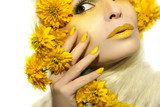 Yellow makeup and manicure with a sharp oval shape of the nails on the girl with the flowers. Obrazy do Salonu Kosmetycznego Obraz
