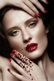 Beautiful girl with evening make-up, red lips in rhinestones and design manicure nails. beauty face. Photos shot in studio Obrazy do Salonu Kosmetycznego Obraz