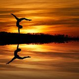 silhouette of female gymnast doing a handstand in sunset  Sport Plakat