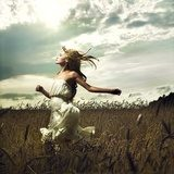 Girl running across field  Ludzie Plakat
