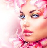 Beautiful Girl With Orchid Flowers. Beauty Woman Face  Ludzie Plakat