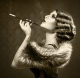 Smoking Retro Woman. Vintage Styled Black and White Photo  Sepia Fototapeta