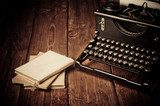 Vintage typewriter and old books, touch-up in retro style  Sepia Fototapeta