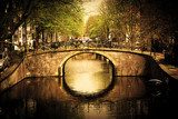 Amsterdam. Romantic bridge over canal.  Fototapety Sepia Fototapeta