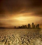 pollution theme with cracked land and the cityscape  Sepia Fototapeta