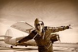 Happy young woman with raised hands  flying on airporte,  Sepia Fototapeta