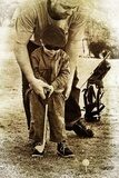 father and son play golf  Sepia Fototapeta