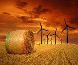 Straw bales with wind turbines in the sunset  Zachód Słońca Fototapeta