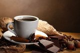 coffee cup and beans, cinnamon sticks, nuts and chocolate  Kawa Fototapeta