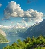 Summer landscape. Blue sky, mountains and fjord  Krajobraz Fototapeta