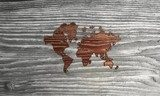 Classy international symbol in a stylish wooden background  Mapa Świata Fototapeta