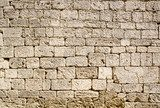Ancient wall built of white stone  Mur Fototapeta