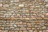 Old medieval wall made from stone  Mur Fototapeta
