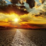 asphalt road and dramatic sunset over it  Niebo Fototapeta