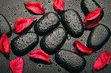 background spa. black stones and red petals with water droplets  Obrazy do Salonu SPA Obraz