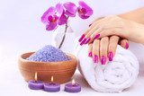 female hands with fragrant orchid and towel. Spa  Obrazy do Salonu SPA Obraz