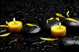 Spa concept-two candle with yellow flower petals on pebbles  Obrazy do Salonu SPA Obraz