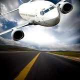 the airplane with the blue sky background.  Pojazdy Fototapeta