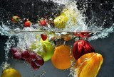 Fruit and vegetables splash into water  Obrazy do Kuchni  Obraz