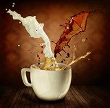 Coffee With Milk Splashing. Cup of Cappuccino or Latte  Fototapety do Kawiarni Fototapeta