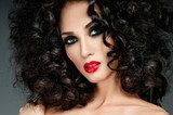 beautiful brunette with gorgeous curly hair  Obrazy do Salonu Fryzjerskiego Obraz