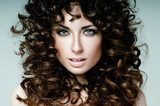 beautiful brunette with curly hair  Obrazy do Salonu Fryzjerskiego Obraz