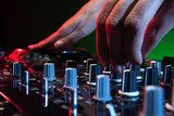 DJ at work. Close-up of DJ hands making music  Muzyka Obraz